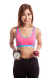 Beautiful Asian healthy girl with clock and apple Royalty Free Stock Photo