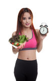 Beautiful Asian healthy girl with clock and salad. Beautiful Asian healthy girl with clock and salad  isolated on white background Stock Images