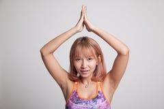 Beautiful Asian healthy girl do yoga pose. Royalty Free Stock Photos