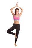Beautiful Asian healthy girl do yoga pose Royalty Free Stock Image