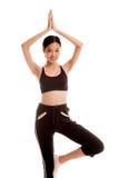 Beautiful Asian healthy girl do yoga pose Stock Photos