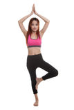 Beautiful Asian healthy girl do yoga pose. Royalty Free Stock Image
