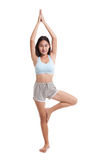 Beautiful Asian healthy girl do yoga pose. Royalty Free Stock Photography