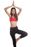 Beautiful Asian healthy girl do yoga pose. Royalty Free Stock Photo