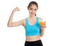 Beautiful Asian healthy girl drinking  orange juice  flexing  bi Stock Photos