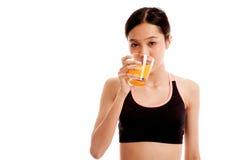 Beautiful Asian healthy girl drinking  orange juice Stock Image