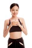 Beautiful Asian healthy girl drinking  orange juice Royalty Free Stock Photo