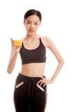 Beautiful Asian healthy girl drinking  orange juice Stock Photo