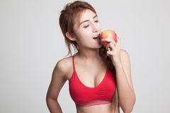Beautiful Asian healthy girl eat apple. Royalty Free Stock Photography