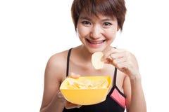 Beautiful Asian healthy girl  eat potato chips. Stock Photography