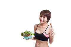 Beautiful Asian healthy girl enjoy eating  salad. Stock Image