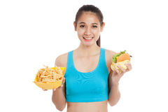 Beautiful Asian healthy girl with french fries and hamburger Stock Photography