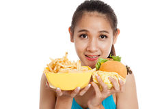 Beautiful Asian healthy girl with french fries and hamburger Stock Photo