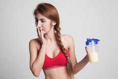 Beautiful Asian healthy girl hate whey protein. Stock Photo