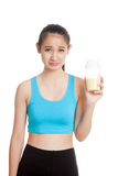 Beautiful Asian healthy girl hate whey protein Stock Image