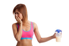 Beautiful Asian healthy girl hate whey protein Royalty Free Stock Photo