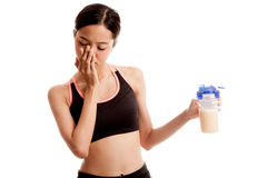 Beautiful Asian healthy girl hate whey protein Stock Images