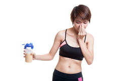 Beautiful Asian healthy girl hate whey protein. Stock Photos