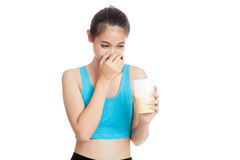 Beautiful Asian healthy girl hate whey protein smell Stock Photo