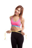 Beautiful Asian healthy girl measuring her waist Stock Images