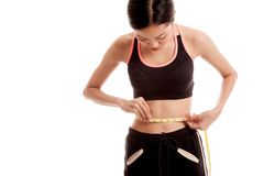 Beautiful Asian healthy girl measuring her waist Royalty Free Stock Photos