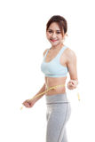Beautiful Asian healthy girl measuring her waist. Stock Photography