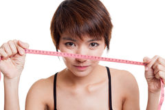 Beautiful Asian healthy girl with measuring tape. Royalty Free Stock Photos