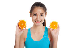 Beautiful Asian healthy girl with orange fruit Royalty Free Stock Photography
