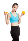 Beautiful Asian healthy girl with orange juice and orange fruit Royalty Free Stock Image