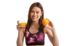 Beautiful Asian healthy girl with orange juice and orange fruit. Stock Photography