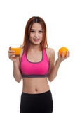 Beautiful Asian healthy girl with orange juice and orange fruit. Beautiful Asian healthy girl with orange juice and orange fruit isolated on white background Stock Image