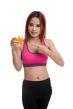 Beautiful Asian healthy girl point to orange juice. Beautiful Asian healthy girl point to orange juice isolated on white background Stock Photos