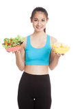 Beautiful Asian healthy girl salad and potato chips. Isolated on white background Stock Image