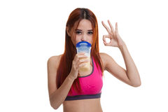 Beautiful Asian healthy girl show OK drink whey protein. Stock Image