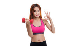 Beautiful Asian healthy girl show OK with dumbbell. Beautiful Asian healthy girl show OK with dumbbell  isolated on white background Royalty Free Stock Photos