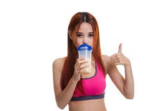 Beautiful Asian healthy girl show thumbs up  drink whey protein. Royalty Free Stock Image