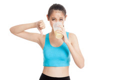 Beautiful Asian healthy girl thumbs down hate whey protein Stock Images