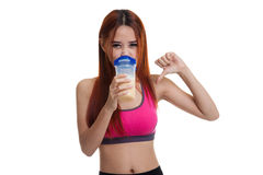 Beautiful Asian healthy girl thumbs down hate whey protein. Stock Photos