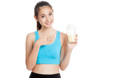 Beautiful Asian healthy girl with whey protein. Isolated on white background Royalty Free Stock Photo