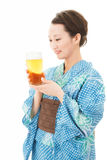 Beautiful asian kimono woman with beer Stock Photos