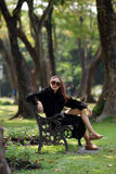 Beautiful Asian lady in black dress, posing in the park, greener Royalty Free Stock Photo