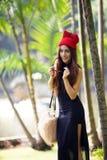 Beautiful Asian lady in black dress, posing in the park, greener Stock Photo