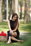 Beautiful Asian lady in black dress, posing in the park, greener Stock Photos