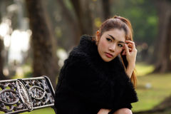 Beautiful Asian lady in black dress, posing in the park, greener Stock Photography