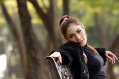 Beautiful Asian lady in black dress, posing in the park, greener Stock Image