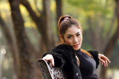 Beautiful Asian lady in black dress, posing in the park, greener Stock Photos