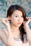 Beautiful Asian lady in front of mosaic Stock Photos