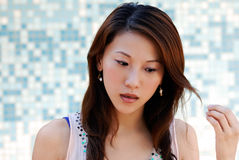 Beautiful Asian lady in front of mosaic Royalty Free Stock Photography