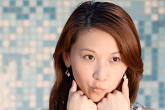 Beautiful Asian lady in front of mosaic Stock Photography