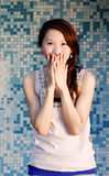 Beautiful Asian lady in front of mosaic and laugh Royalty Free Stock Images